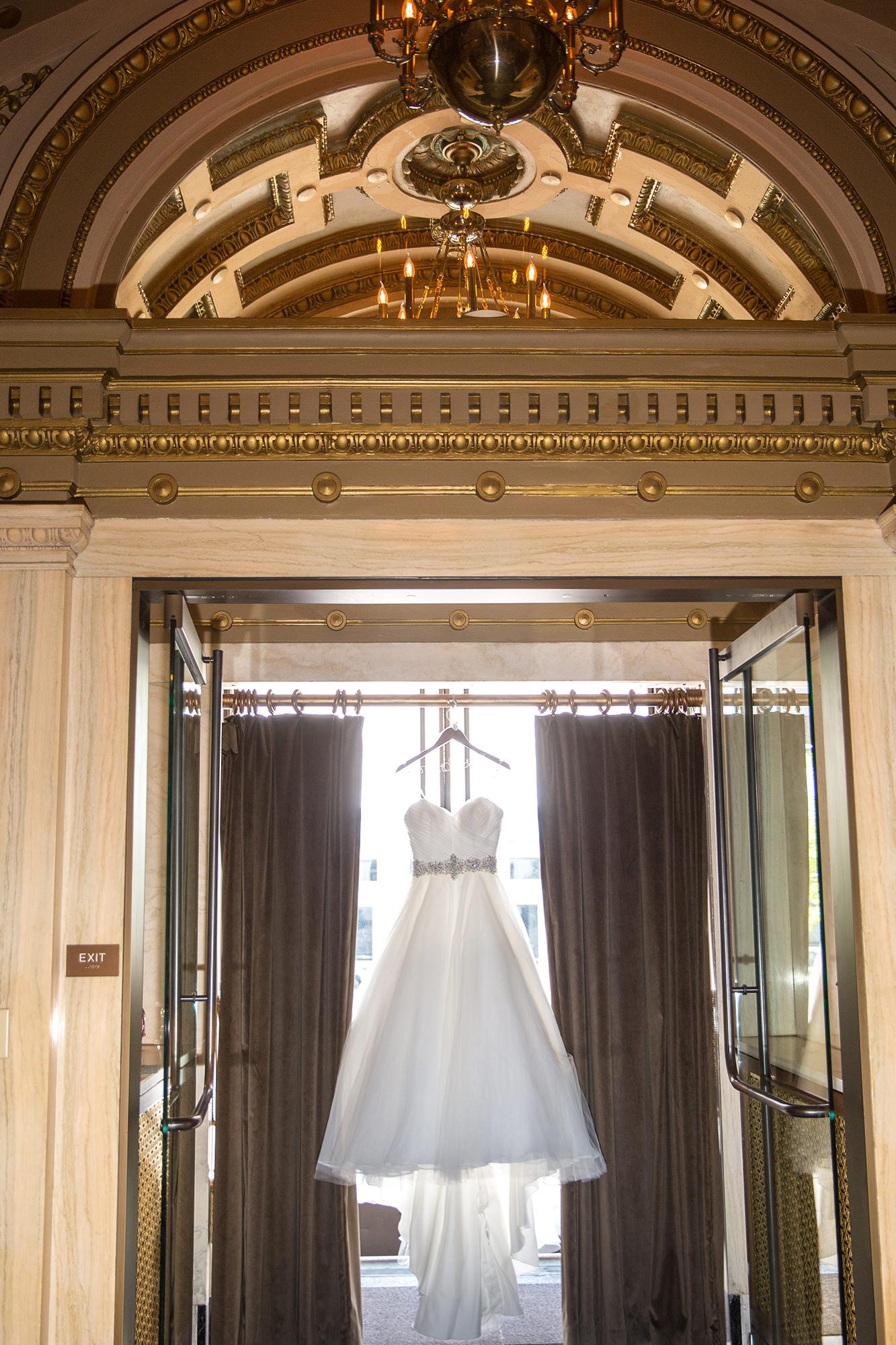 Wedding Dress Hanging In Entry