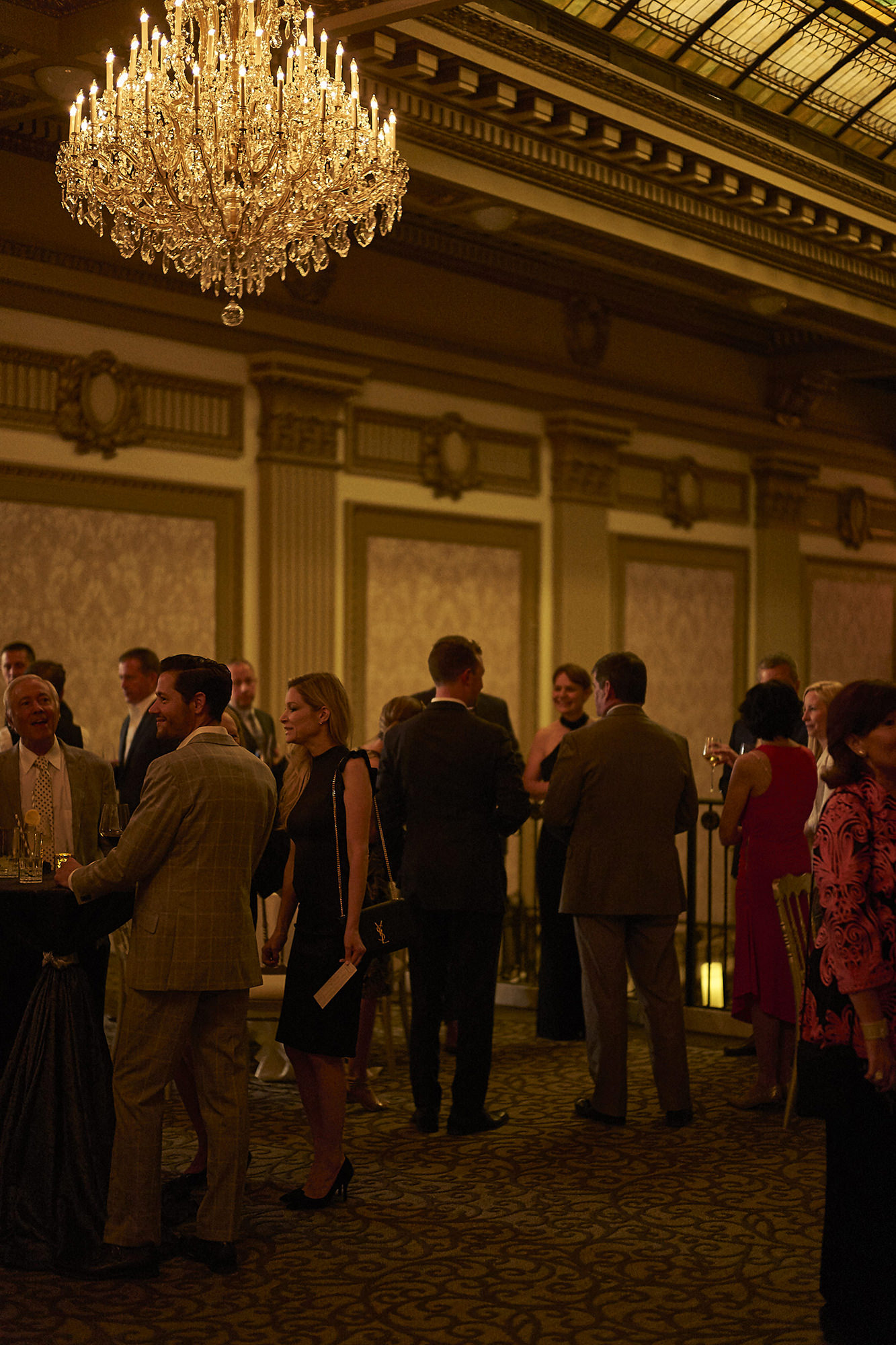 Guests On South Mezzanine With Hess Chandelier