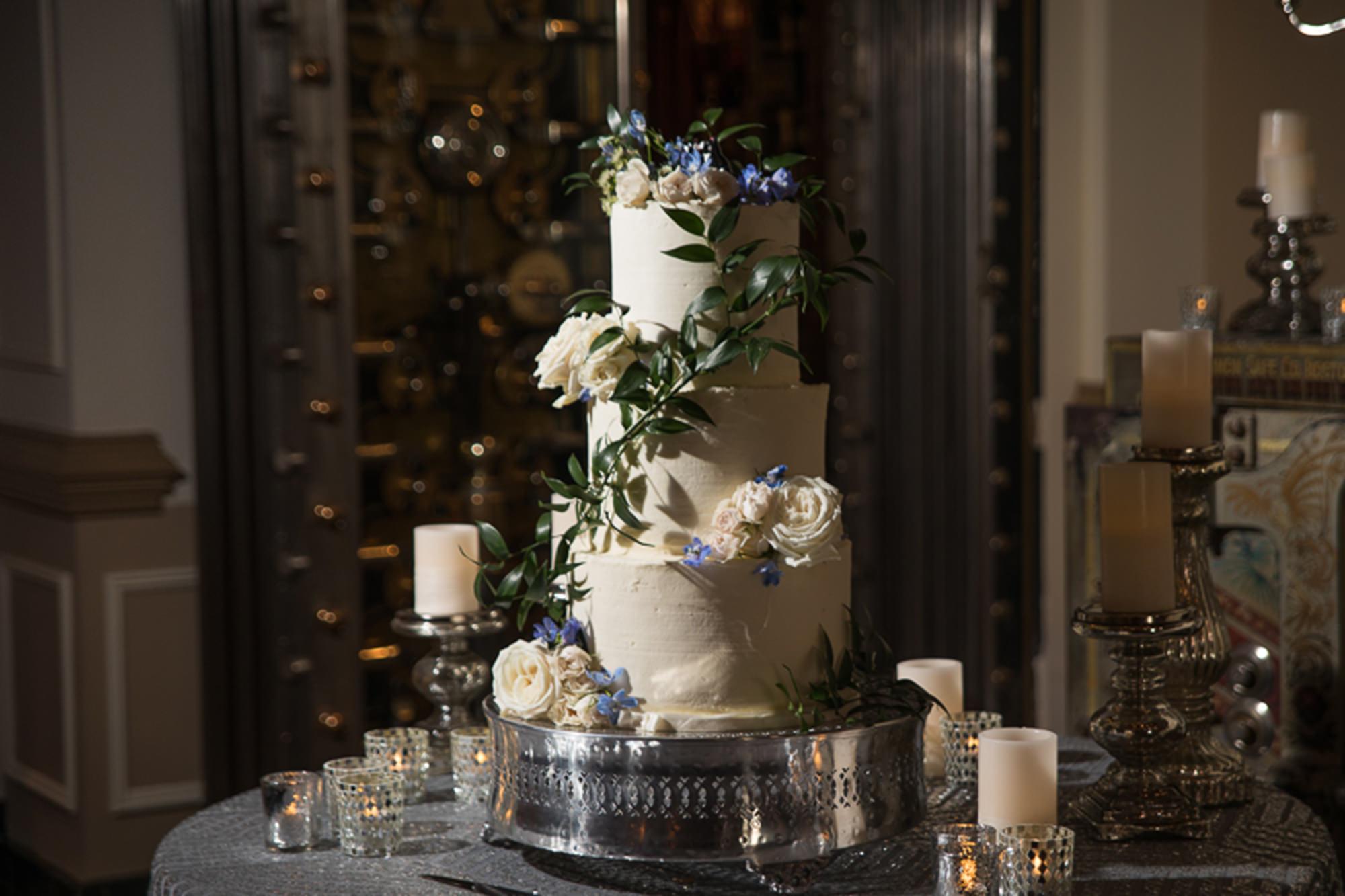 Wedding Cake In Front Of Vault