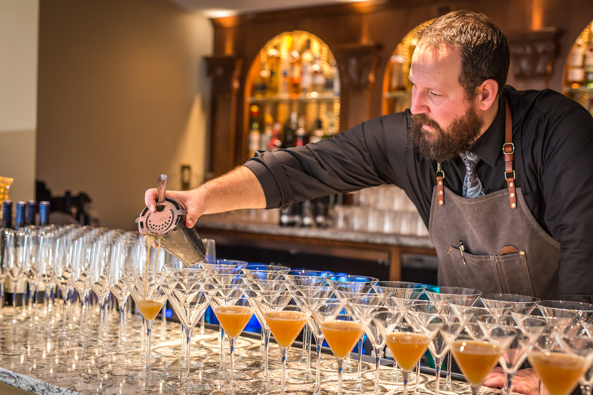 Bartender Pouring Signature Cocktail