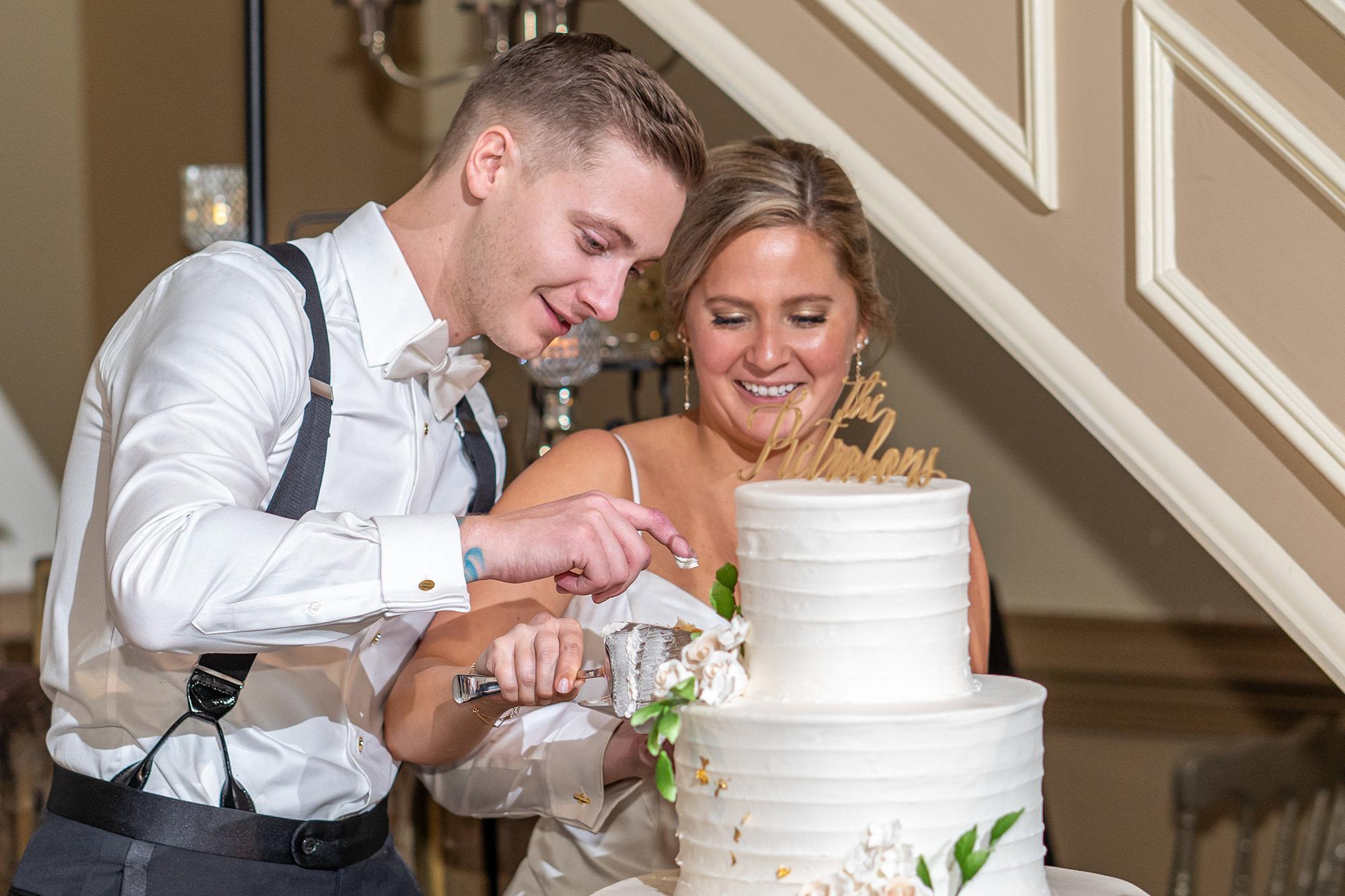 Tara And Michael Cutting Cake
